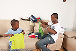 3 year old boy at home with father household chores laundry folding modeling imitation horizontal