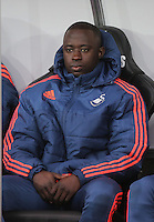 Modou Barrow of Swansea on the bench during the Barclays Premier League match between Swansea City and Crystal Palace at the Liberty Stadium, Swansea on February 06 2016