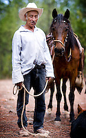 An apple orchard farmer and occasional tour guide with his horse in Urique Canyon in Cerocahui, Mexico, Friday, June 20, 2008. While forestry and apple harvesting is traditional to Cerocahui, the tourist industry is growing rapidly...PHOTOS/ MATT NAGER