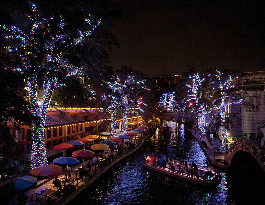Holiday lights illuminate the world famous Riverwalk as a tour barge sails past in Downtown San Antonio. Nearly two million LED lights have been placed along the river in the Alamo City, one of the top ten Holiday tourist destinations in the United States. (Darren Abate/VisitSanAntonio.com)