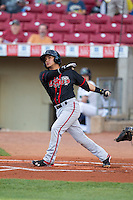 Lansing Lugnuts shortstop Jorge Flores #1 bats during a game against the Cedar Rapids Kernels at Veterans Memorial Stadium on April 29, 2013 in Cedar Rapids, Iowa. (Brace Hemmelgarn/Four Seam Images)