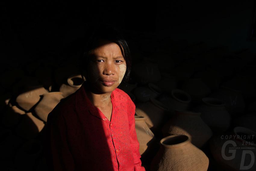 Women carrying Pots at a Pottery in Sagaing, Mandalay Myanmar/Burma