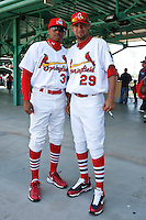 Adron Chambers (31) and Eduardo Sanchez (29) sign autographs April 20th, 2010; Midland Texas Rockhounds vs The Springfield Cardinals at Hammons Field in Springfield Missouri.  The Cardinals won in the 9th inning breaking a 1-1 tie.