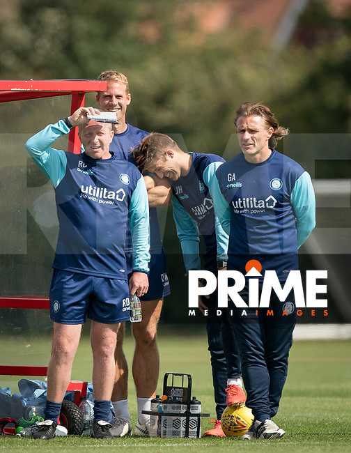 (L-r) Wycombe Wanderers Assistant Manager Richard Dobson, Wycombe Wanderers Sports Scientist David Wates, Wycombe Wanderers Analyst Josh Hart & Wycombe Wanderers Manager Gareth Ainsworth during the behind closed doors friendly between Brentford B and Wycombe Wanderers at Brentford Football Club Training Ground & Academy, 100 Jersey Road, TW5 0TP, United Kingdom on 3 September 2019. Photo by Andy Rowland.