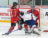 Dario Burgler (EV Zug - Switzerland) tries to stop Julius Sinkovic (Val-d'Or - Slovakia) as he heads into Reto Berra (GCK Lions Zurich - Switzerland). The Suisse defeated Slovakia 2-1 in a 2007 World Juniors match on January 2, 2007, at FM Mattson Arena in Mora, Sweden.