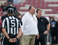 Hawgs Illustrated/BEN GOFF <br /> Bret Bielama, Arkansas head coach, and Will Muschamp, South Carolina head coach, talk before the game Saturday, Oct. 7, 2017, at Williams-Brice Stadium in Columbia, S.C.
