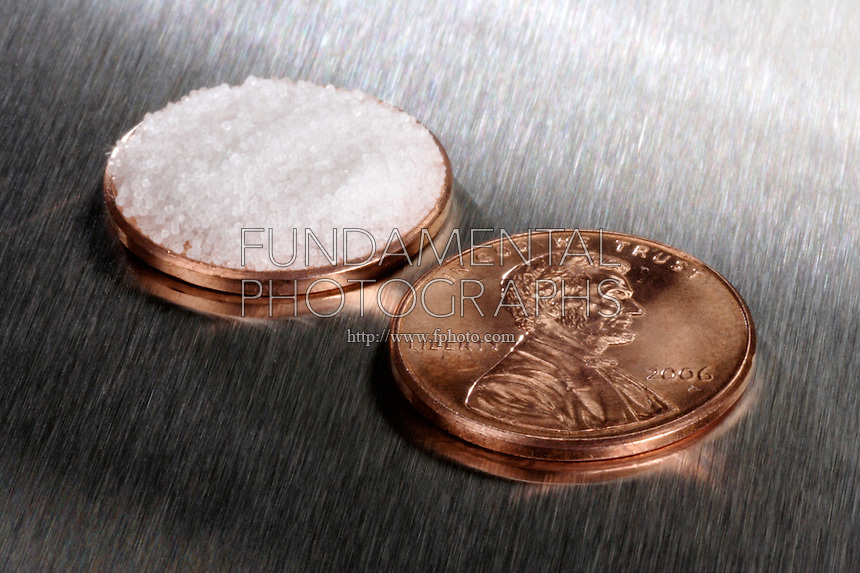 1/16 TEASPOON OR 0.3g OF SALT COMPARED TO A PENNY<br /> Minimum Daily Requirement of Salt<br /> A penny in relation to the suggested minimum daily requirement of salt.