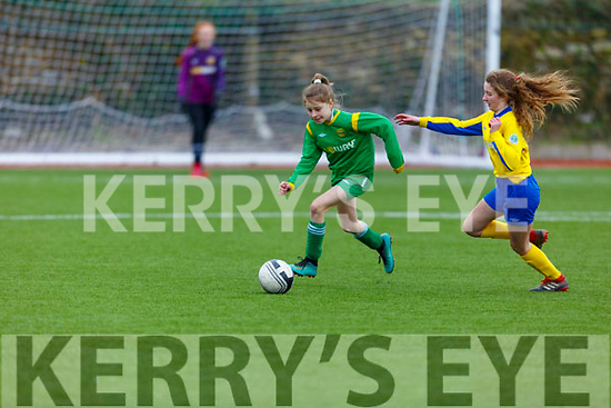 Kerry's Trina Kennedy in possession as Tipperary's Eva Cremins keeps an eye on her in their U13 encounter on Sunday.