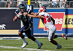 October 22, 2011:   Nevada Wolf Pack's Rishard Matthews uses a straight arm to break away from Fresno State Bulldogs Andrew Shapiro as he returns a punt 76 yards for a touchdown in the first quarter during a WAC league game played at Mackay Stadium in Reno, Nevada.