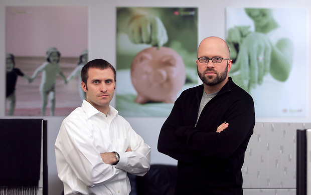 Mike Ferrari, left, and Jon Gaskell, co-founders of Des Moines-based SmartyPig, an online company that promotes savings through social networking.