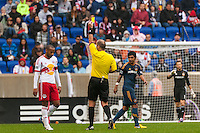 Thierry Henry (14) of the New York Red Bulls gets a yellow card from referee Silviu Petrescu. The New York Red Bulls defeated the Los Angeles Galaxy 1-0 during a Major League Soccer (MLS) match at Red Bull Arena in Harrison, NJ, on May 19, 2013.