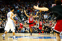 PITTSBURGH, PA - MARCH 21: Ralston Turner #22 of the North Carolina State Wolfpack celebrates during the closing moments of their 71-68 win over the Villanova Wildcats during the third round of the 2015 NCAA Men's Basketball Tournament at Consol Energy Center on March 21, 2015 in Pittsburgh, Pennsylvania.  (Photo by Jared Wickerham/Getty Images)
