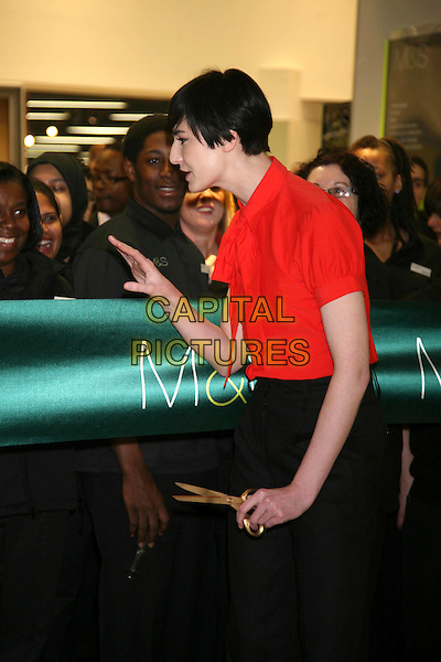 ERIN O'CONNOR.Opens the new M&S store at Colliers Wood, South London, England..May 1st, 2008.M & S Marks & Spencer half length red blouse black trousers cutting ribbon profile scissors hand .CAP/DS.©Dudley Smith/Capital Pictures