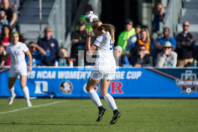 Cary, North Carolina - Sunday December 6, 2015: Rebecca Quinn (5) of the Duke Blue Devils heads the ball during second half action against the Penn State Nittany Lions at the 2015 NCAA Women's College Cup at WakeMed Soccer Park.  The Nittany Lions defeated the Blue Devils 1-0.