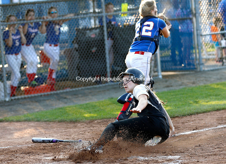 West Haven, CT- 10 June 2015-061015CM010-  Thomaston's Morgan Sanson  slides safely into home ahead of a throw to Hale Ray catcher Aidan Fiala during their Class S semi-final matchup in West Haven on Wednesday.  Thomaston won, 14-4 advancing to Class S state finals.    Christopher Massa Republican-American