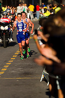 25 JUN 2011 - PONTEVEDRA, ESP - Jonathan Brownlee (GBR) (left) and Alistair Brownlee (GBR) lead Dmitry Polyansky (RUS) on the run at the Elite Men's European Triathlon Championships in Pontevedra, Spain (PHOTO (C) NIGEL FARROW)