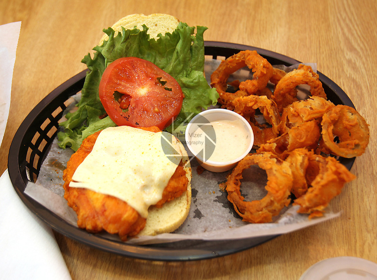 032112tvwingstreetbuffalo.The Buffalo Chicken sandwich combo, with onion rings..BND/TIM VIZER    with SunMag story