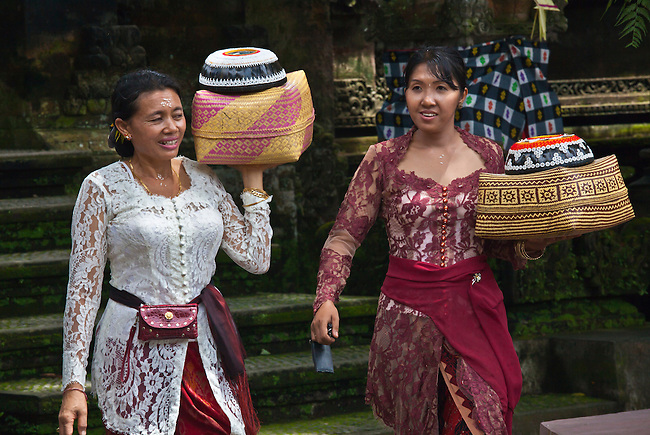 Women bring offerings at PURA TAMAN SARASWATI during the GALUNGAN FESTIVAL - UBUD, BALI, INDONESIA