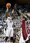 March 1, 2012: Nevada Wolf Pack gaurd Malik Story shoots over New Mexico State Aggies forward Remi Barry during their NCAA basketball game played at Lawlor Events Center on Thursday night in Reno, Nevada.