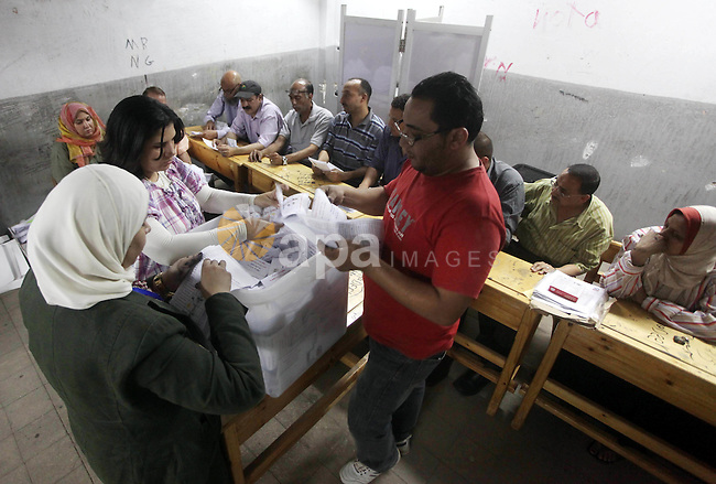 Egyptian election officials count ballots of the first round of Egypt's presidential elections, in a polling station in Cairo, Egypt, at the end of the election's second day on 24 May 2012. Polling stations closed at 9 p.m. (1900 GMT) after the Egyptian election commission extended voting by one hour to encourage more people to vote on 24 May after turnout was low on the second and last day of Egypt's first free presidential election. According to the election commission the counting of ballots was about to start immediately. More than 50 million eligible voters were casting their ballots over the two-day polls. Results are not expected until 29 May 2012. Photo by Ashraf Amra