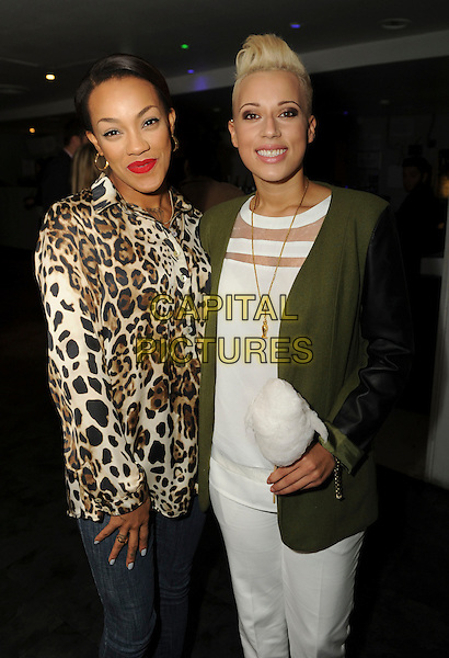 Stooshe (Karis Anderson, Courtney Rumbold)<br /> 'Bloggers Love' Gifting Suite Event at the Penthouse, Leicester Square. London, England.<br /> 17th September 2013<br /> half length white blazer brown green leopard print top band group red lipstick mouth open jeans denim trousers <br /> CAP/PP/GM<br /> &copy;Gary Mitchell/PP/Capital Pictures