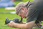 22 February 2013: Washington Post Photographer John McDonnell gets low for a photo during a full squad Spring Training workout at Space Coast Stadium in Viera, Florida. Mandatory Credit: Ed Wolfstein Photo *** RAW File Available ***