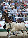 Kory Koontz competes in the team roping event at the Reno Rodeo in Reno, Nev., on Friday, June 20, 2014.<br />