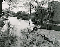 1953 October 23..Assisted Housing..Tidewater Gardens (6-2 & 6-9)...Slum Conditions.Flooded Street..PHOTO CRAFTSMEN INC..NEG# 18-640.NRHA# 643..