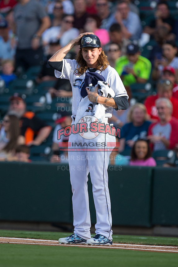 International League All-Star pitcher Mike Clevinger (39) of the Columbus Clippers puts on a batting helmet as he attempts to be the last player standing on the line following the National Anthem at the 29th Annual Triple-A All-Star Game at BB&T BallPark on July 13, 2016 in Charlotte, North Carolina.  The International League defeated the Pacific Coast League 4-2.   (Brian Westerholt/Four Seam Images)