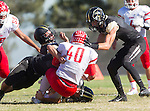Palos Verdes, CA 10/24/14 - Michael Navarro (Redondo Union #40), Jason Burr (Peninsula #7) and Ashton Jones (Peninsula #50)in action during the Redondo Union - Palos Verdes Peninsula CIF Varsity football game at Peninsula High School.