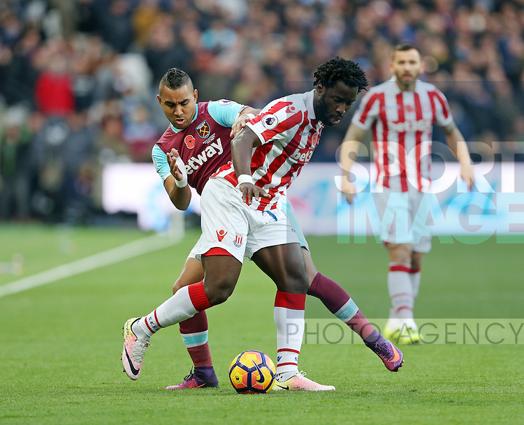 West Ham's Dimitri Payet tussles with Stoke's Wilfred Bony during the Premier League match at the London Stadium, London. Picture date November 5th, 2016 Pic David Klein/Sportimage