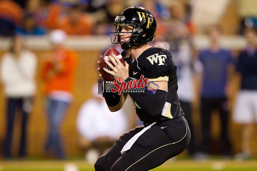 Tanner Price (10) of the Wake Forest Demon Deacons drops back to pass against the Clemson Tigers at BB&T Field on October 25, 2012 in Winston-Salem, North Carolina.  The Tigers defeated the Demon Deacons 42-13.  (Brian Westerholt/Sports On Film)