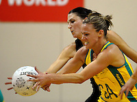 Australian captain Sharelle McMahan takes a pass under pressure from Anna Scarlett. International Netball  - New Zealand Silver Ferns v Australian Diamonds Constellation Cup match at TSB Bank Arena, Wellington on Thursday, 2 September 2010. Photo: Dave Lintott/lintottphoto.co.nz.