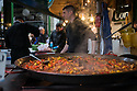 London, UK. 15.11.2014. A steaming paella pan of curry cooks away at Borough Market. Photograph © Jane Hobson.