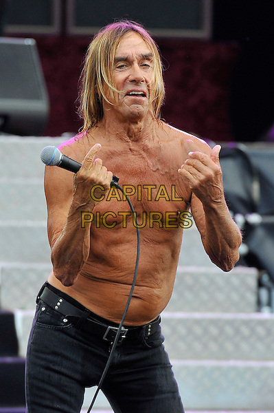 Iggy Pop of Iggy and the Stooges.performing at Hard Rock Calling, Hyde Park, London, England, UK, .13th July 2012..festival concert music gig live on stage .half length topless chest torso  black belt jeans  hand veins  microphone wrinkly tanned .CAP/MAR.© Martin Harris/Capital Pictures.