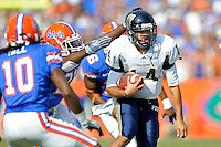 21 November 2009:  FIU quarterback Wayne Younger (14) carries the ball in the first half as the University of Florida Gators defeated the FIU Golden Panthers, 62-3, at Ben Hill Griffin Stadium in Gainesville, Florida.