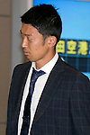 """Japan national football team, Shuichi Gonda, June 27, 2014, Chiba, Japan - Suichi Gonda arrives at Narita International Airport with other members of the Japan national football team. Members of the Japan national football team arrives at Narita with a disappointed look on their faces. They couldn't advance to the final 16 in """"2014 FIFA World Cup Brazil"""" and came back earlier. (Photo by Rodrigo Reyes Marin/AFLO)"""