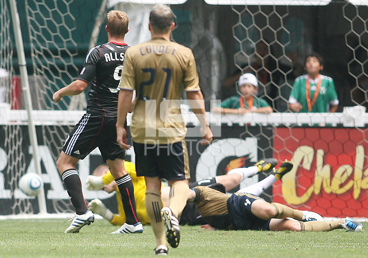 Danny Allsopp #9 of D.C. United watches his shot beat Danny Califf #4 and Chris Seitz #1 of the Philadelphia Union for the first goal during an MLS match at RFK Stadium on August 22 2010, in Washington DC. United won 2-0.