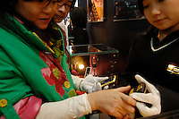 "Mobile telephones by xxx, called the ultimate jewellery phone, valued at 100,000 rnb (£7,000 sterling) at the ""Top Show"" luxury goods fair in Shenzhen, China."