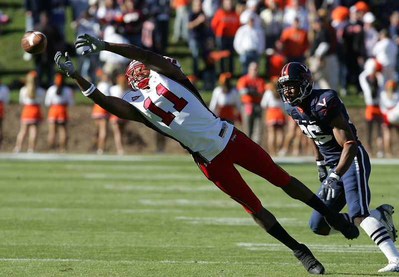Maryland's Drew Weatherly(11) misses the catch in front of Virginia's Chris Cook Saturday October 14, 2006 during a college football game at Scott Stadium in Charlottesville, Va. (AP Photo/The Daily Progress/Andrew Shurtleff)