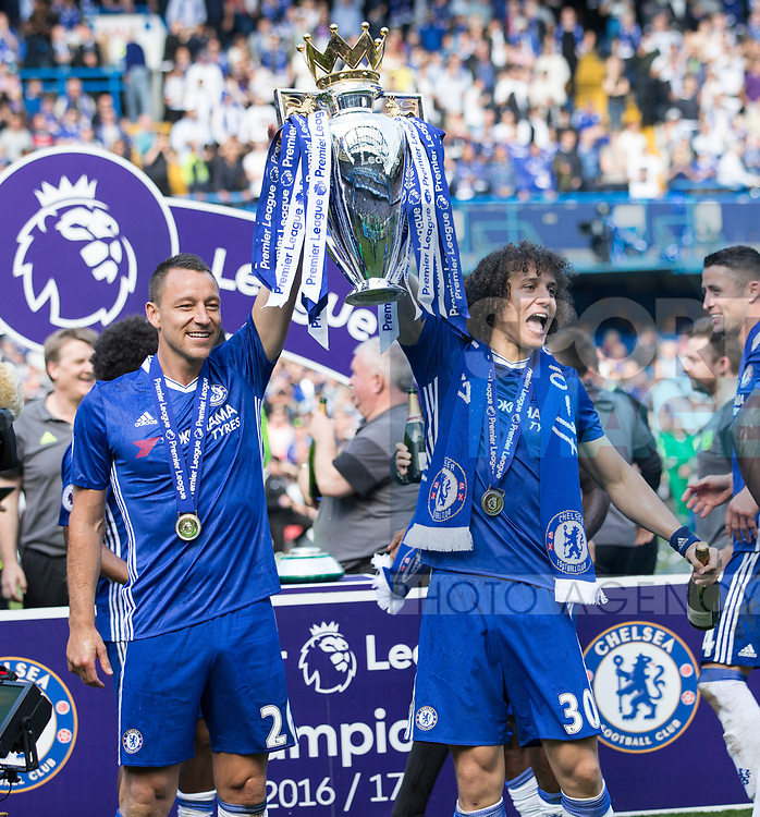 Chelsea's John Terry and David Luiz celebrate with the trophy during the Premier League match at Stamford Bridge Stadium, London. Picture date: May 18th, 2017. Pic credit should read: David Klein/Sportimage