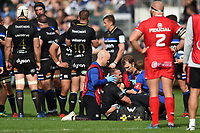 Jamie Roberts of Bath Rugby is tested for concussion symptoms during a break in play. Heineken Champions Cup match, between Bath Rugby and Stade Toulousain on October 13, 2018 at the Recreation Ground in Bath, England. Photo by: Patrick Khachfe / Onside Images
