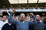 Supporters in the South Stand react with delight as the home team take the lead as Tottenham Hotspur took on Watford in an English Premier League match at White Hart Lane. Spurs were due to make an announcement in April 2016 regarding when they would move out of their historic home and relocate to Wembley as their new stadium was completed. Spurs won this match 4-0 watched by a crowd of 31,706, a reduced attendance figure due to the ongoing ground redevelopment.