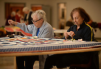 NWA Democrat-Gazette/ANDY SHUPE<br /> Joyce Lemons (left) and Marilee Henderson of West Fork sit together Thursday, Nov. 7, 2019, as they work to quilt a friendship quilt for Paula Dutton in The Frank Wenzel Community Center in West Fork. The two are members of the West Fork Quilters Club, which was first organized in April 1991 and meets on Thursday mornings at the center.