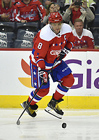 WASHINGTON, DC - MARCH 26: Washington Capitals left wing Alex Ovechkin (8) stickhandles a rolling puck during the Carolina Hurricanes vs. Washington Capitals NHL game March 26, 2019 at Capital One Arena in Washington, D.C.. (Photo by Randy Litzinger/Icon Sportswire)
