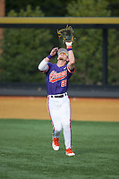 Clemson Tigers right fielder Seth Beer (28) catches a fly ball during the game against the Wake Forest Demon Deacons at David F. Couch Ballpark on March 12, 2016 in Winston-Salem, North Carolina.  The Tigers defeated the Demon Deacons 6-5.  (Brian Westerholt/Four Seam Images)