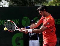 BOGOTA - COLOMBIA -08 -11-2013: Thomaz Bellucci, tenista de Brasil devuelve la bola a Paolo Lorenzi, tenista italiano, durante partido de cuartos de final del Seguros Bolivar Open en el Club Campestre el Rancho de la ciudad de Bogota. / Thomaz Bellucci, Brazil tennis player returns the ball to Paolo Lorenzi, italian tennis player during a match for the quarter finals of the Seguros Bolivar Open in the Club Campestre El Rancho in Bogota city. Photo: VizzorImage  / Luis Ramirez / Staff.