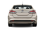 Straight rear view of a 2018 Ford Fusion Hybrid SE 4 Door Sedan stock images