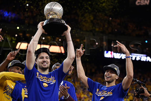 30.05.2016. Oakland, CA, USA - Golden State Warriors' Klay Thompson (11) lifts the NBA Western Conference championship trophy in the air as teammate Stephen Curry (30) celebrates on Monday, May 30, 2016, at Oracle Arena in Oakland, Calif. The Warriors won 96-88  to go through to the best of 7 finals versus Cleveland.