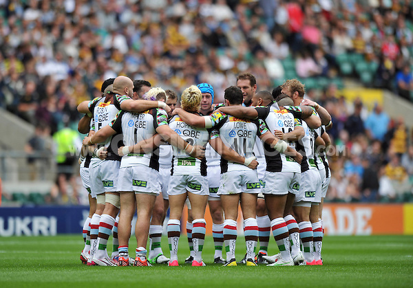 Harlequins players huddle together just prior to the match. Aviva Premiership Double Header match, between London Wasps and Harlequins on September 1, 2012 at Twickenham Stadium in London, England. Photo by: Patrick Khachfe / Onside Images